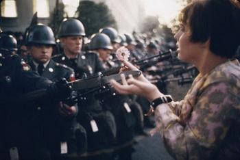 hippie_puts_flower_in_gun1